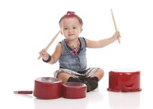 Little Drummer. Adorable toddler dressed as a rock star with a pink Mohawk and banging on pots and pans with drum sticks.  Isolated on white Stock Photos