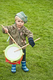 Little drummer at Braemar Gathering. Small boy emulating drummers in pipe band while attending Braemar Royal Highland Gathering lheld 1st September 2012 Stock Photography