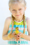 Little duckling. Smiling little girl holding a little duckling Royalty Free Stock Photo