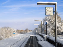 Little Dutch railway station in the country. In the snow with a single rail-track Stock Photo