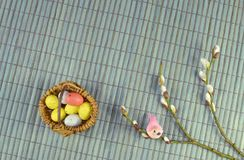 A little easter basket with easter eggs and branches of pussy-willow royalty free stock images