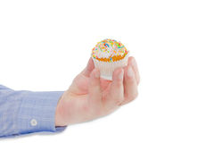 Little Easter cake in male hand on a light background Stock Photos