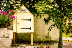 A Little Egg Hut. A miniature hut situated at a farm entrance, on the roadside. Used to house Eggs for Sale Royalty Free Stock Photo