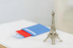 Little Eiffel tower standing on the table Stock Photo