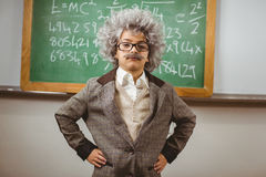 Little Einstein posing in front of chalkboard Stock Photos