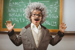 Little Einstein smiling in front of chalkboard Royalty Free Stock Photography