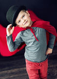 Little elegant magician boy touching his hat Royalty Free Stock Image