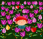 Little elf and the tulips Stock Image