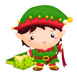 Little elf with an unwrap gift. At Santa's workshop Stock Photo