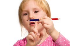 Little emotional girl with blue and red  pencil Stock Image
