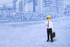 Little engineer on blueprint background Royalty Free Stock Photography