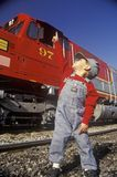 A little engineer in engineer cap with a historic Santa Fe Diesel train in Los Angeles, CA Royalty Free Stock Images