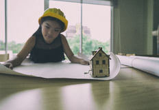 Little engineer girl in the safety helmet with a construction bl Royalty Free Stock Photos