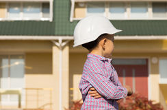 Little Engineer Kid Looking at the House Seriously Stock Images