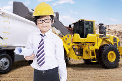 Little engineer and loader machine Royalty Free Stock Image