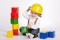 Little engineer plays with cubes Stock Photography