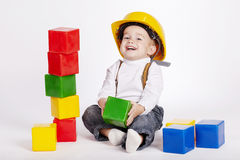Little engineer plays with cubes Royalty Free Stock Photography