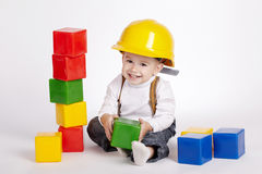 Little engineer plays with cubes Stock Photos