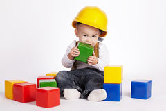 Little engineer plays with cubes Royalty Free Stock Photo