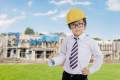 Little engineer standing near the building site Stock Image