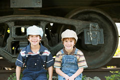 Little Engineers. Two Little Boys Sitting by a Train Stock Images