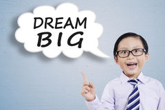Little entrepreneur and Dream Big text Royalty Free Stock Image