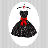 Little evening dress black on hangers Stock Photography
