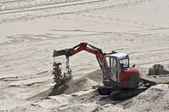 Little excavator in the sand Royalty Free Stock Photography