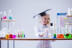 Little experimenter looks for evaporation reagent Royalty Free Stock Photo