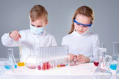 Little experts. Two children making chemical experimentsin laboratory Royalty Free Stock Image