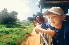 Little expiorer boy with his father on jeep safari stock photo