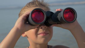 Little explorer with binoculars stock footage