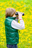 Little explorer in a field Stock Photo