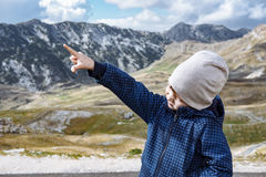 Little explorer hiking in autumn mountains Durmitor, Montenegro Stock Images