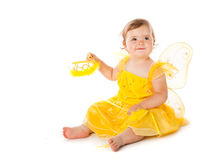 Little fairy. In yellow dress . Isolated on white background Stock Image