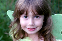 Little fairy. A soft focus image of a little girl in a fairy costume with big brown eyes royalty free stock photography