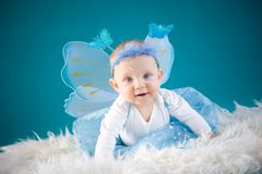 Little fairy. Cute baby girl on blue background Stock Images