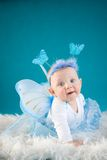 Little fairy. Baby girl on blue backgrouns Royalty Free Stock Photography