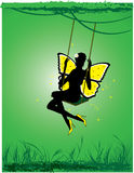 Little fairy. Shakes on a swing in the forest Stock Image