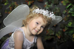 Little fairy. With a basket of flowers Royalty Free Stock Photo