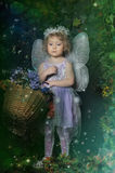 Little fairy. With a basket of flowers Stock Photography