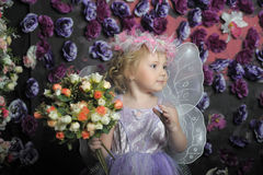 Little fairy. With a basket of flowers Stock Photo