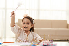 Little fairy. Girl pretending to practice witchcraft with her pen Royalty Free Stock Photo