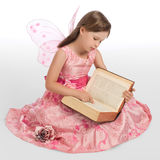 Little fairy magic book reads Royalty Free Stock Photos
