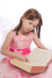 Little fairy magic book reads Stock Images