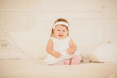 Little fairy sitting on the bed Stock Photography