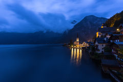 Little famous Hallstatt village in Alps at dusk in Austria Stock Photo