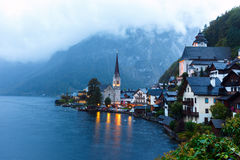 Little famous Hallstatt village in Alps at dusk in Austria Royalty Free Stock Images