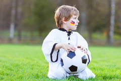 Little fan boy at public viewing of soccer or football game Stock Image