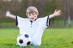 Little fan boy at public viewing of soccer or football game Royalty Free Stock Photography